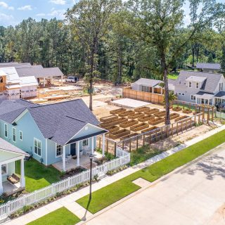 Two great views of our new community garden from above surrounded by brand new cottages! Will you be planting today? #shreveportla #southshreveport #provenancecommunity #traditionalneighborhooddevelopment